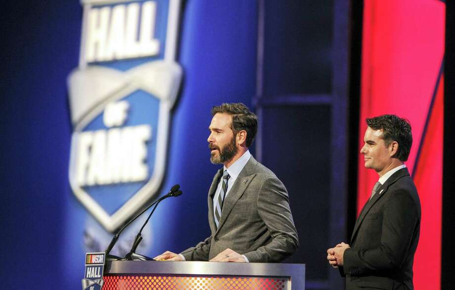 Jimmie Johnson, left, and Jeff Gordon introduce team owner Rick Hendrick during the NASCAR Hall of Fame induction ceremony last Friday. Photo: Mike McCarn — The Associated Press   / FR34342 AP