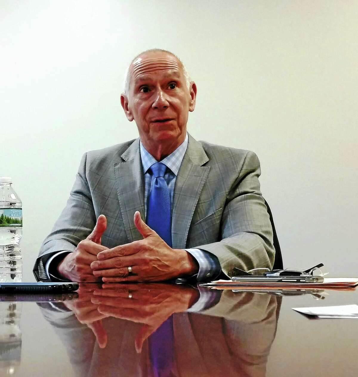 Mark E. Ojakian, president of the Connecticut State Colleges and Universities, speaks to the New Haven Register Editorial Board recently.