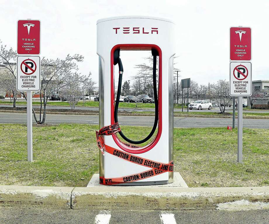Tesla chargers have been installed in the parking lot of the Connecticut Post Mall in Milford. Photo: Arnold Gold — New Haven Register