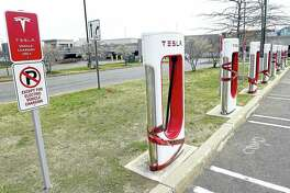Arnold Gold — New Haven Register    Tesla chargers are lined up in the parking lot of the Connecticut Post Mall in Milford.