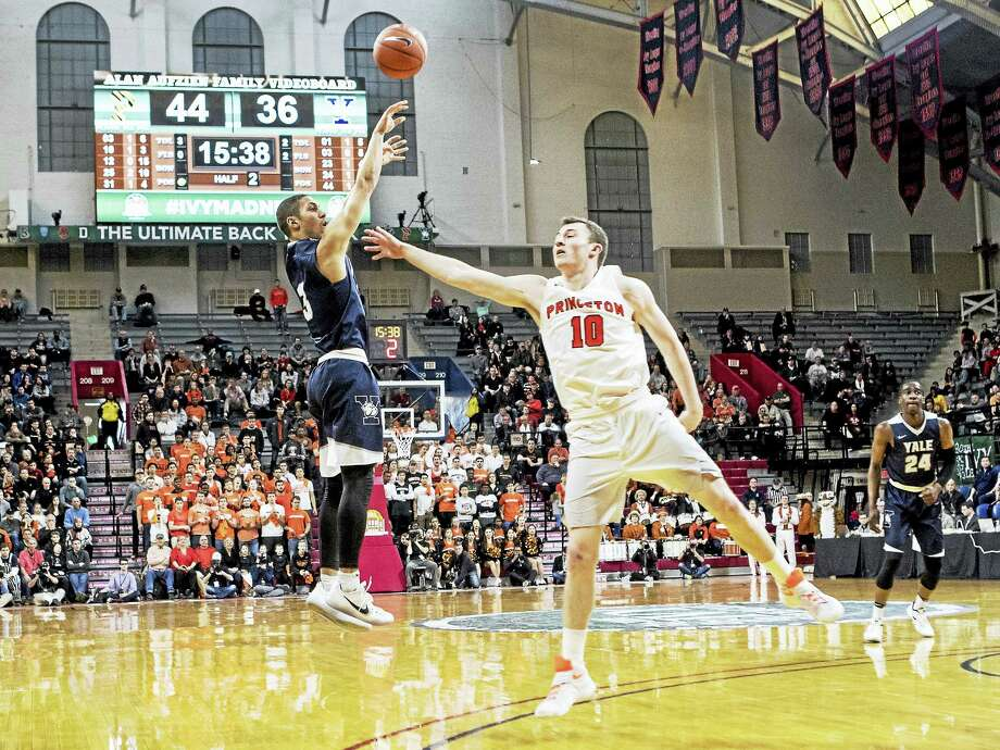 Yale's Alex Copeland shoots over a Princeton defender during the Ivy League championship game on Saturday in Philadelphia. Photo: Submitted Photo By Steve Musco   / ©2017 Steve Musco. All rights reserved.