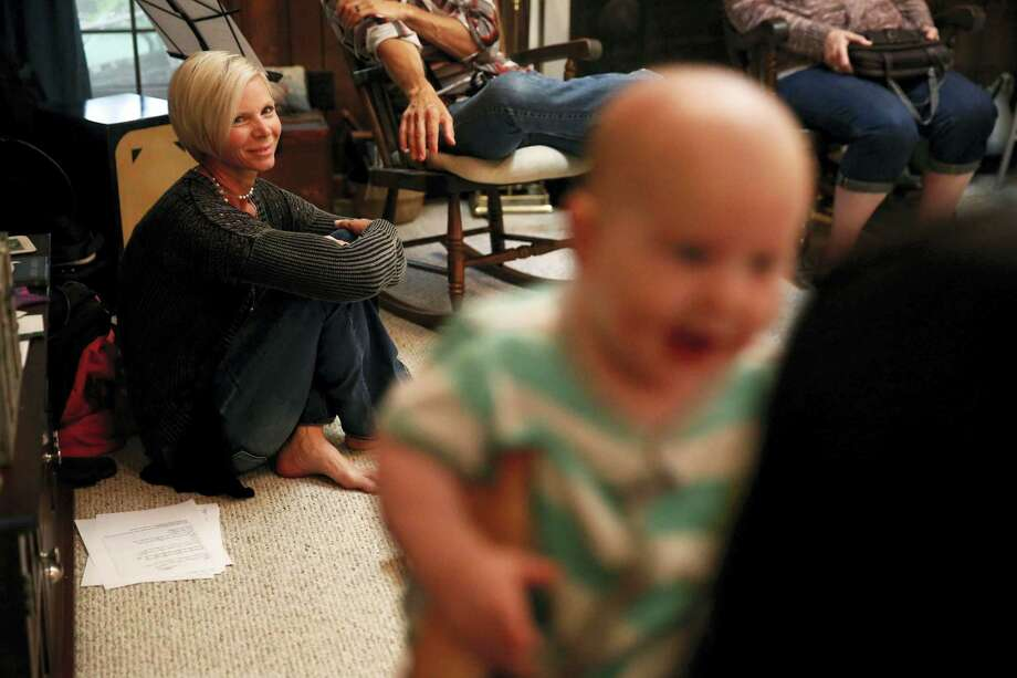In this May 22, 2016 file photo, Denise Wilkes, left, looks at baby Noah Burton, sitting on a fellow worshiper's lap, during a church service in Birmingham, Ala. Emma and Noah continued their reign as the most popular baby names last year. Photo: AP Photo — Brynn Anderson, File / Copyright 2017 The Associated Press. All rights reserved.