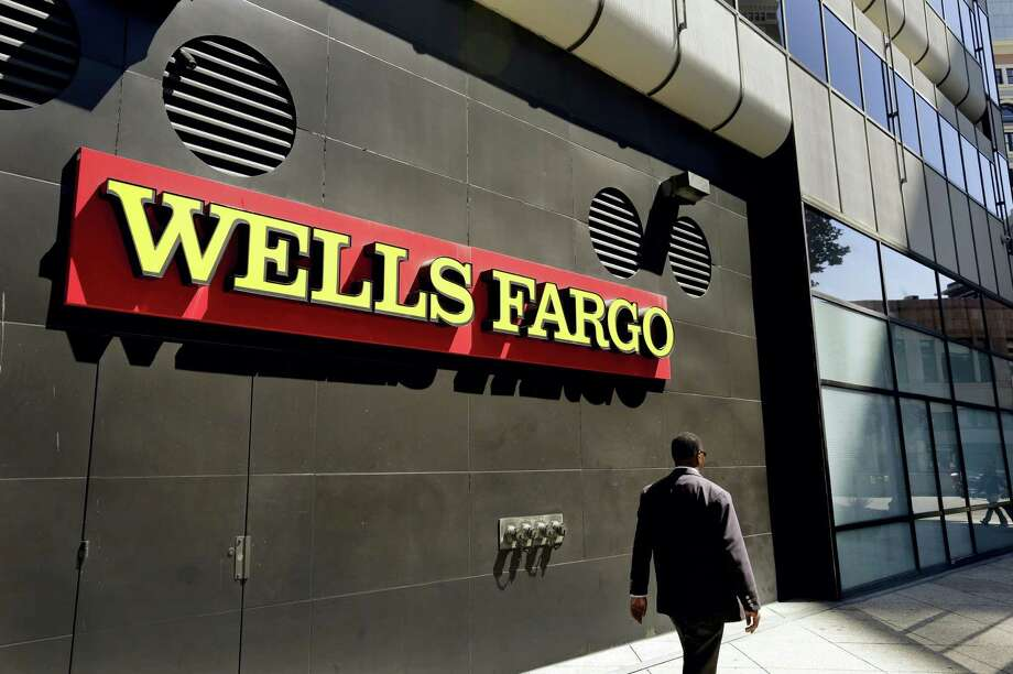 In this July 14, 2014 file photo, a man passes by a Wells Fargo bank office in Oakland, Calif. Lawyers suing Wells Fargo on behalf of aggrieved customers say in court filing late Thursday, May 11, 2017, the bank may have opened about 3.5 million unauthorized accounts, far more than the figure bank and regulators disclosed last year. Photo: Ben Margot — AP Photo File    / Copyright 2017 The Associated Press. All rights reserved.