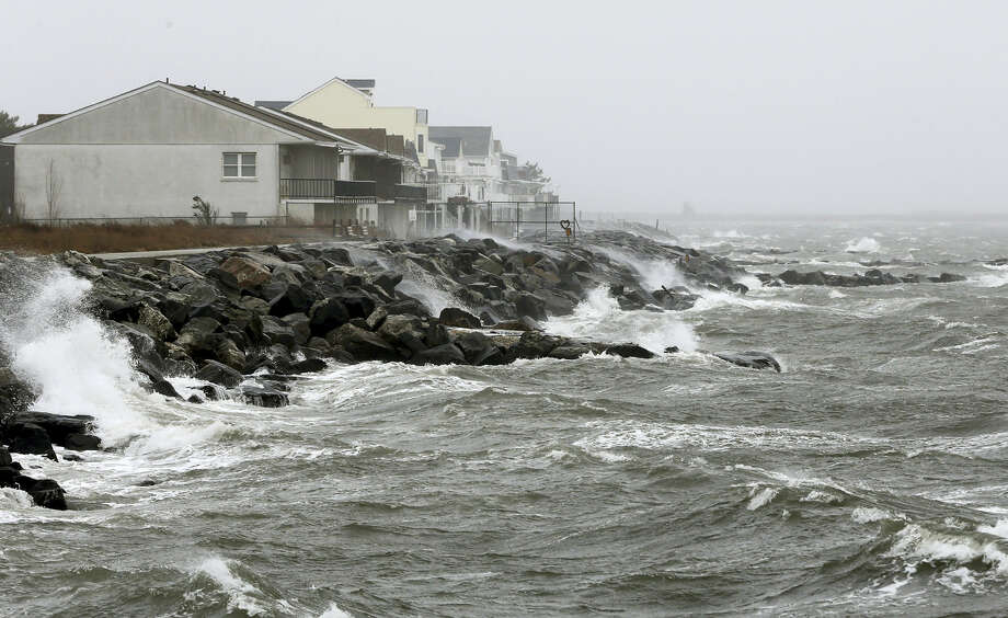 Strong northeast winds drive waves onto the seawall along Hereford Inlet in the Anglesea section of North Wildwood, N.J., Monday. Photo: The Associated Press   / The Press of Atlantic City