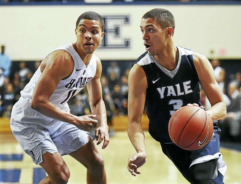 Yale's Alex Copeland drives around Harvard's Bryce Aiken during Saturday's game at the John J. Lee Amphitheater. Photo: Catherine Avalone — Register   / Catherine Avalone/New Haven Register