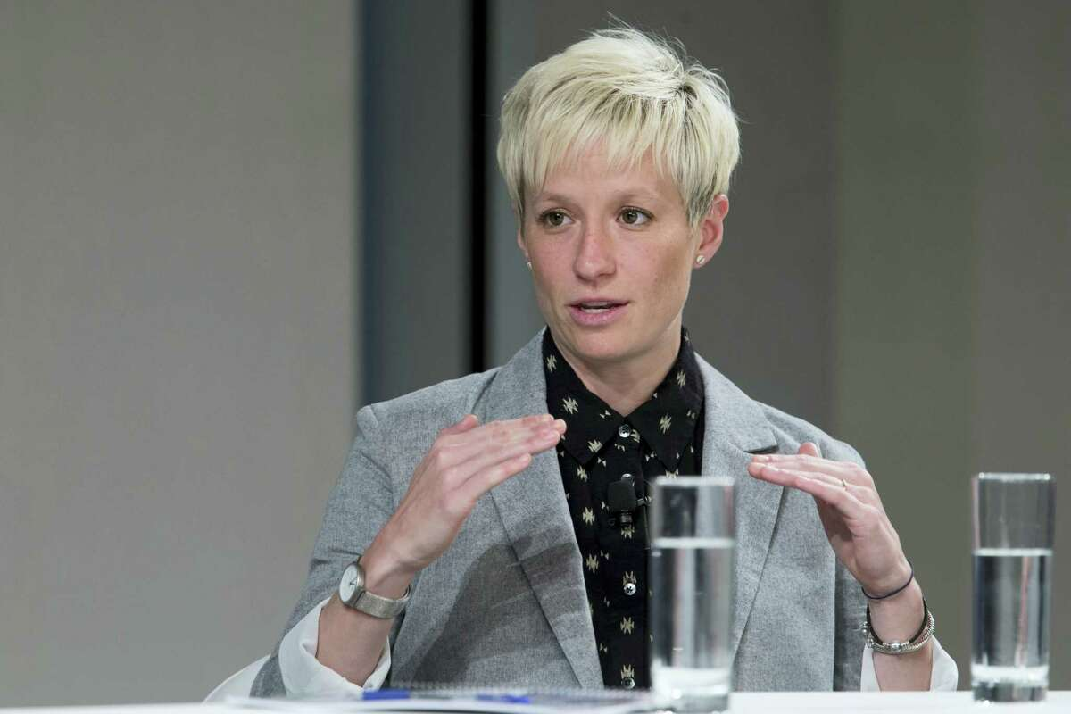 In this April 12, 2016 photo, U.S. women's soccer player Megan Rapinoe speaks during a Glassdoor Pay Equality Roundtable in New York. The U.S. Soccer Federation and the World Cup champion women's team have agreed on a labor contract, settling a dispute in which the players sought equitable wages to their male counterparts. The financial terms and length of the multiyear deal were not disclosed. The agreement was ratified by the players and the federation's board on April 4, 2017.