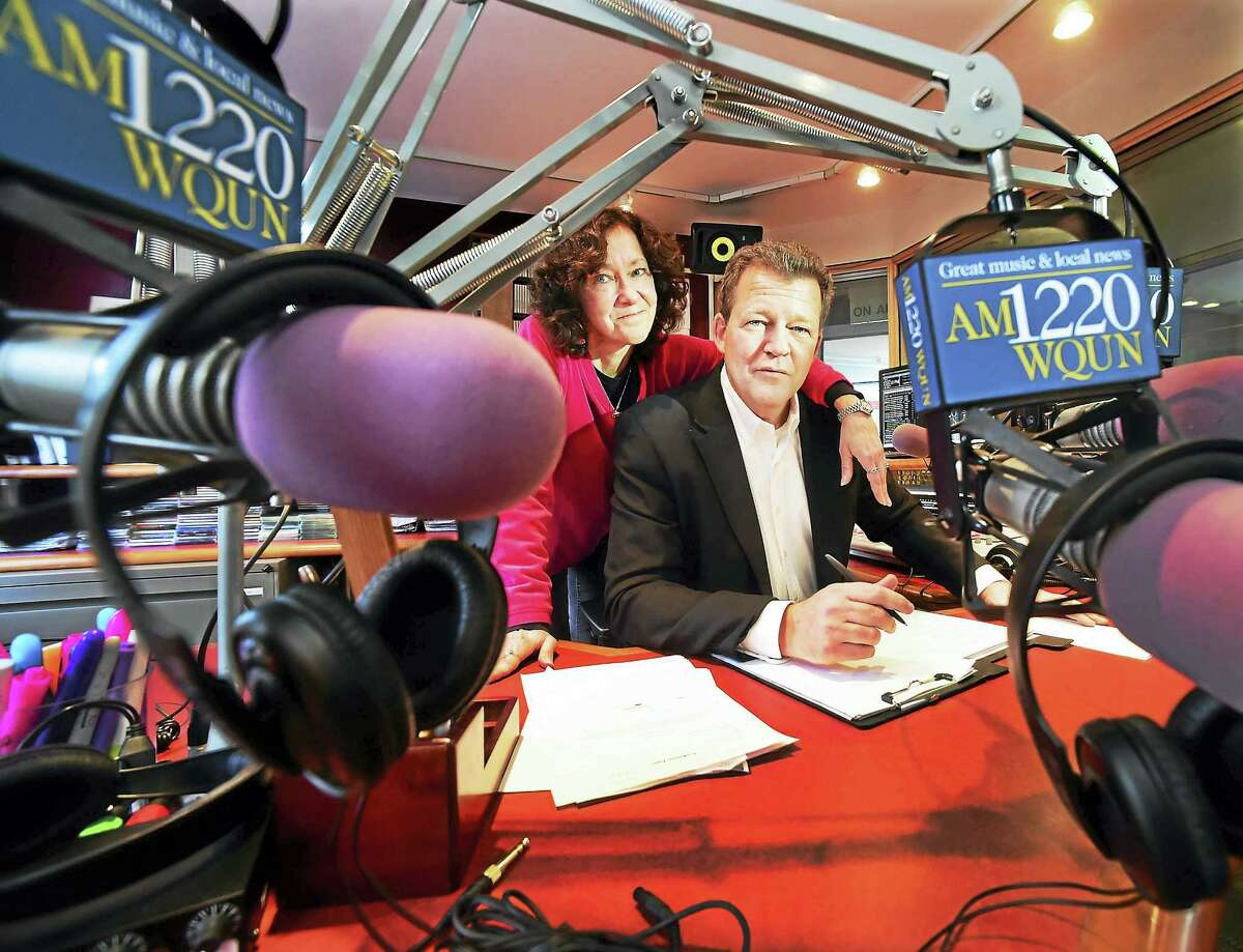 """Pam Landry, WQUN-AM operations manager with radio personality Brian Smith, formerly of WPLR's """"Smith & Barber"""" show, at the WQUN studios in Hamden."""