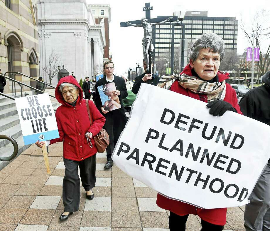 Norma Contois, right, of Branford leads the annual March for Life on Church Street in New Haven Monday. Photo: Arnold Gold — New Haven Register