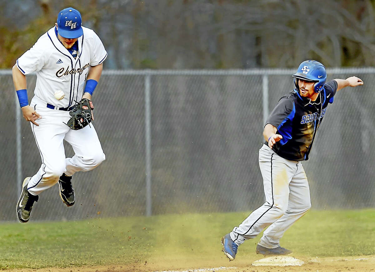 Jack Zagaja of the University of New Haven tries to control the baseball as Nick Lamberti of Southern Connecticut State University holds at third base during the fifth-inning Wednesday.