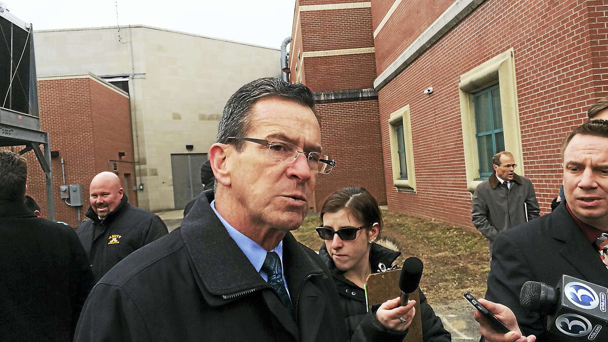 Gov. Dannel P. Malloy listens to a reporter's question Monday during a ribbon-cutting event for a fuel cell at Amity Regional High School in Woodbridge.