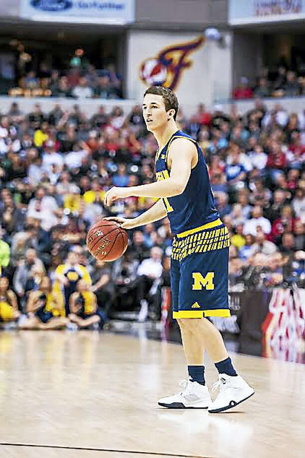Andrew Dakich, a back-up point guard at Michigan for three years, transferred to Quinnipiac last week. Photo: Photo Courtesy Of University Of Michigan Athletics   / Copyright 2016, ? Michigan Photography. ALL RIGHTS RESERVED.  (734) 764-9217. photography.umich.edu.