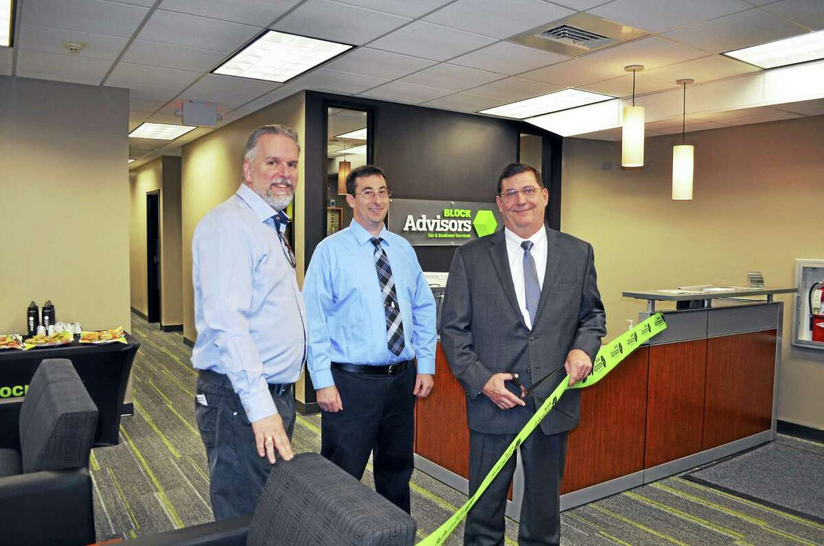 NEW ON THE BLOCK: West Haven Mayor Edward M. O'Brien cuts the ribbon with Chamber of Commerce Director Alan R. Olenick, left, and Block Advisors tax adviser and office manager William Smith Jan. 12 to celebrate the grand opening of the tax preparation service's office in the Professional Centre at 98 Elm St. To mark the occasion, the new office hosted a four-hour networking event in conjunction with 346 Block Advisors offices nationwide, including eight in Connecticut. Block Advisors also offers year-round bookkeeping and payroll services.