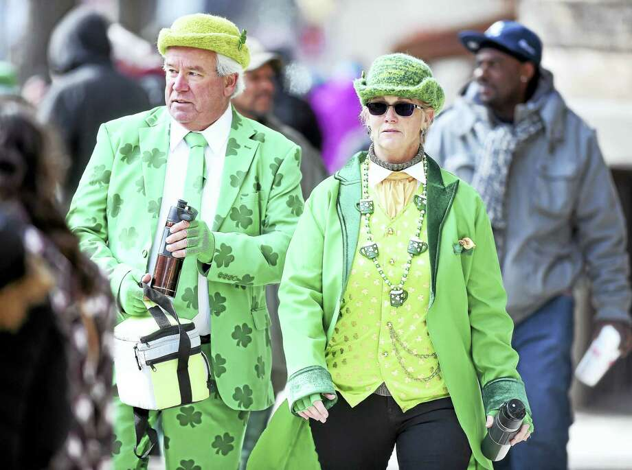 Arnold Gold-New Haven Register  Ed and Karen O'Brien of Meriden walk down Chapel Street during a frosty St. Patrick's Day Parade. Photo: Digital First Media