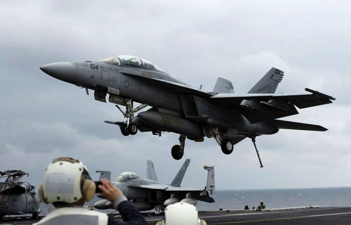 In this March 14, 2017, file photo, a U.S. Navy's F/A-18 Super Hornet fighter approaches the deck of the Nimitz-class aircraft carrier USS Carl Vinson during the annual joint military exercise called Foal Eagle between South Korea and the United States at an unidentified location in the international waters, east of the Korean Peninsula. North Korea fired a ballistic missile into the waters off its east coast on Wednesday, April 5, South Korean officials said, in a continuation of its weapons launches made as the country is angrily reacting to annual military drills between U.S. and South Korean troops.