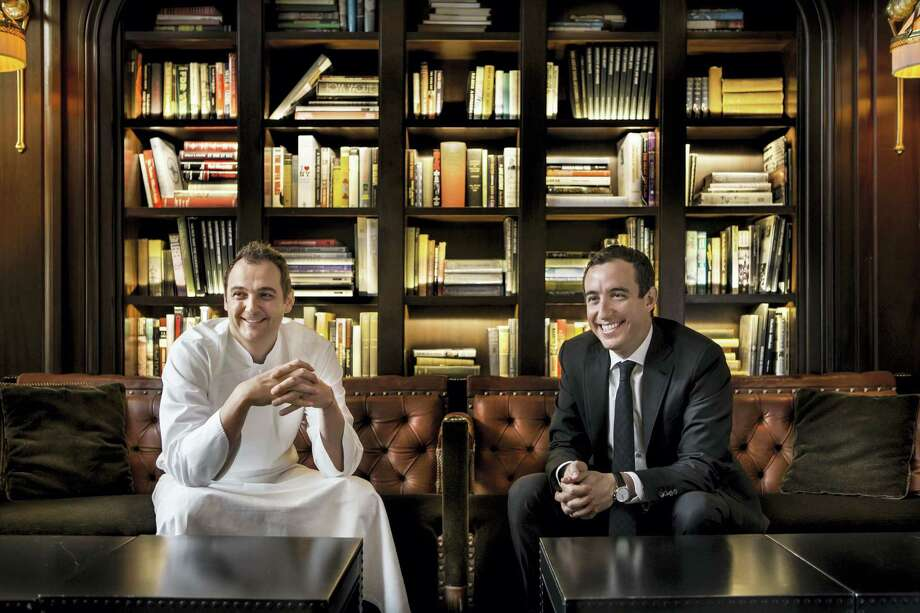 This photo provided by Francesco Tonelli shows co-owners Daniel Humm and Will Guidara in the library of the NoMad restaurant in New York. Chef Humm and his business partner Guidara are owners of Eleven Madison Park and the more casual NoMad restaurants. (Francesco Tonelli via AP) Photo: AP / Francesco Tonelli via Wicked Good Media
