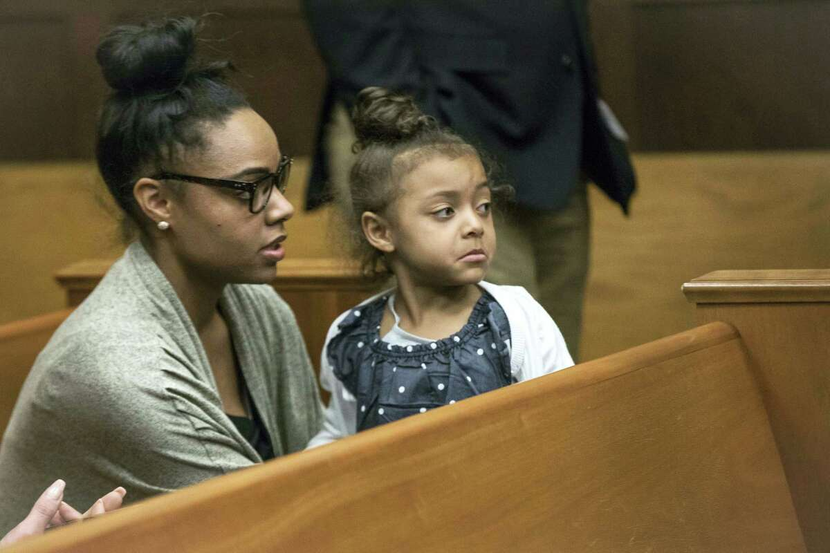 """In this Wednesday, April 12, 2017, file photo, Shayanna Jenkins-Hernandez, fiancee of former New England Patriots tight end Aaron Hernandez, sits in the courtroom with the couple's daughter during jury deliberations in Hernandez's double-murder trial at Suffolk Superior Court in Boston. Jenkins-Hernandez said in an interview on """"Dr. Phil"""" scheduled to air in May 2017 that she thought """"some cruel person"""" was playing a trick on her when she heard Hernandez had hanged himself in his prison cell April 19, days after he was acquitted of a double murder. He was still serving a life sentence for another killing."""