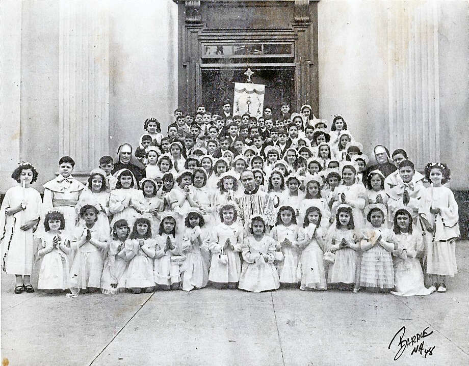 Photo courtesy Richard Biondi  St. Michael first communion 1953. St. Michael Church, the epicenter and heartbeat of Wooster Square, celebrated 1,175 baptisms and 190 weddings  in 1913. Photo: Digital First Media