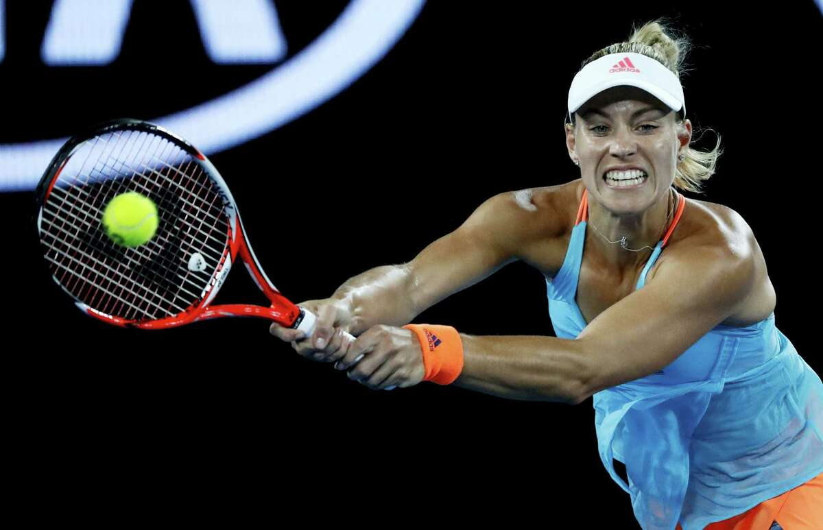 Germany's Angelique Kerber makes a backhand return to United States' Coco Vandeweghe during their fourth round match at the Australian Open tennis championships in Melbourne, Australia on Jan. 22, 2017.