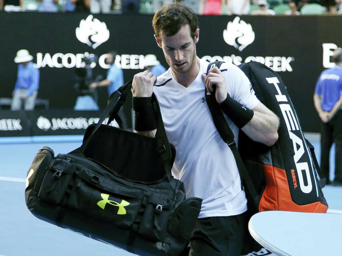Britain's Andy Murray carries his bags from the court following his fourth round loss to Germany's Mischa Zverev at the Australian Open tennis championships in Melbourne, Australia on Jan. 22, 2017.