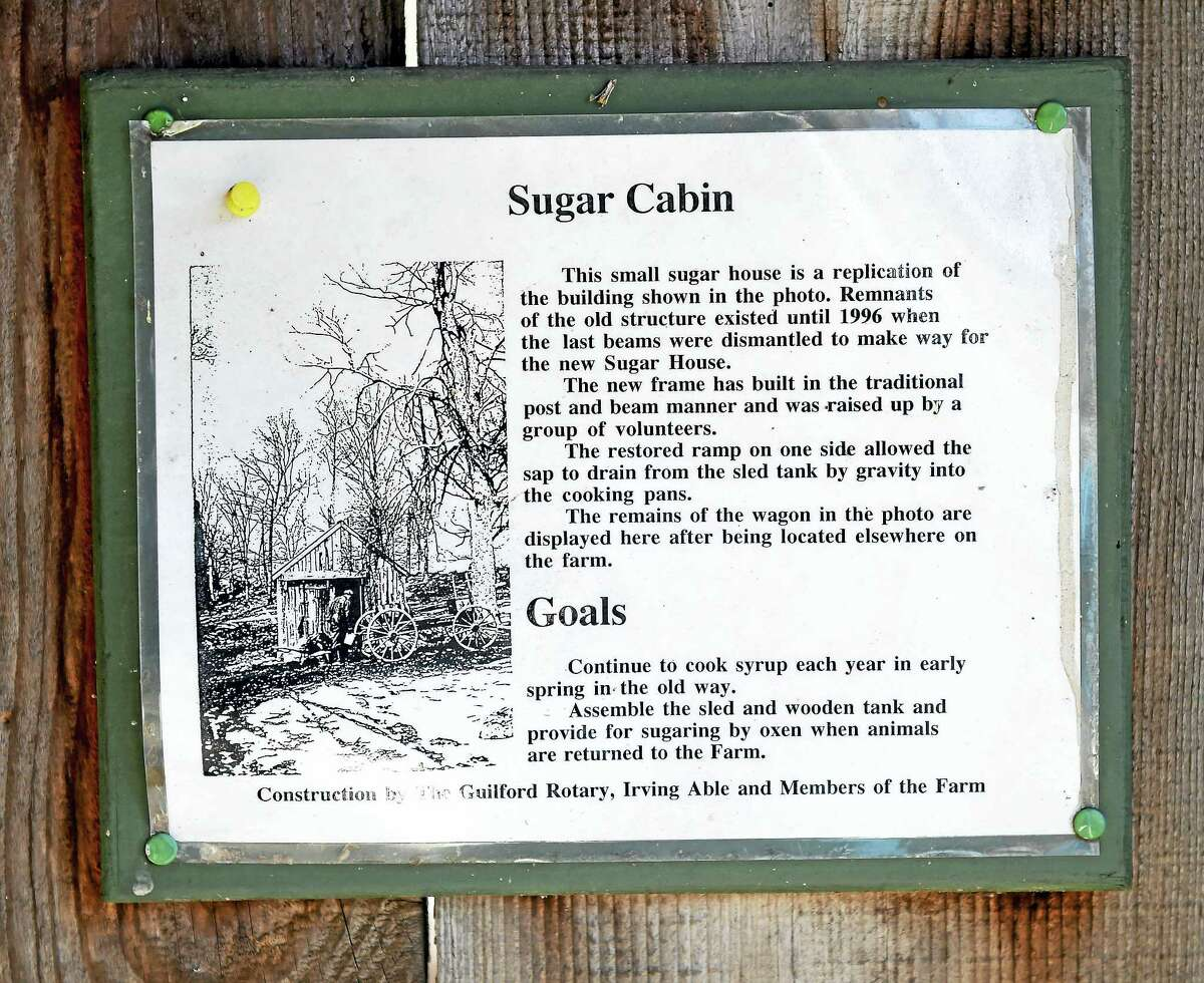 Arnold Gold — New Haven Register A sign details the history of the Sugar Cabin at the Dudley Farm Museum in Guilford on Feb. 4, 2017.