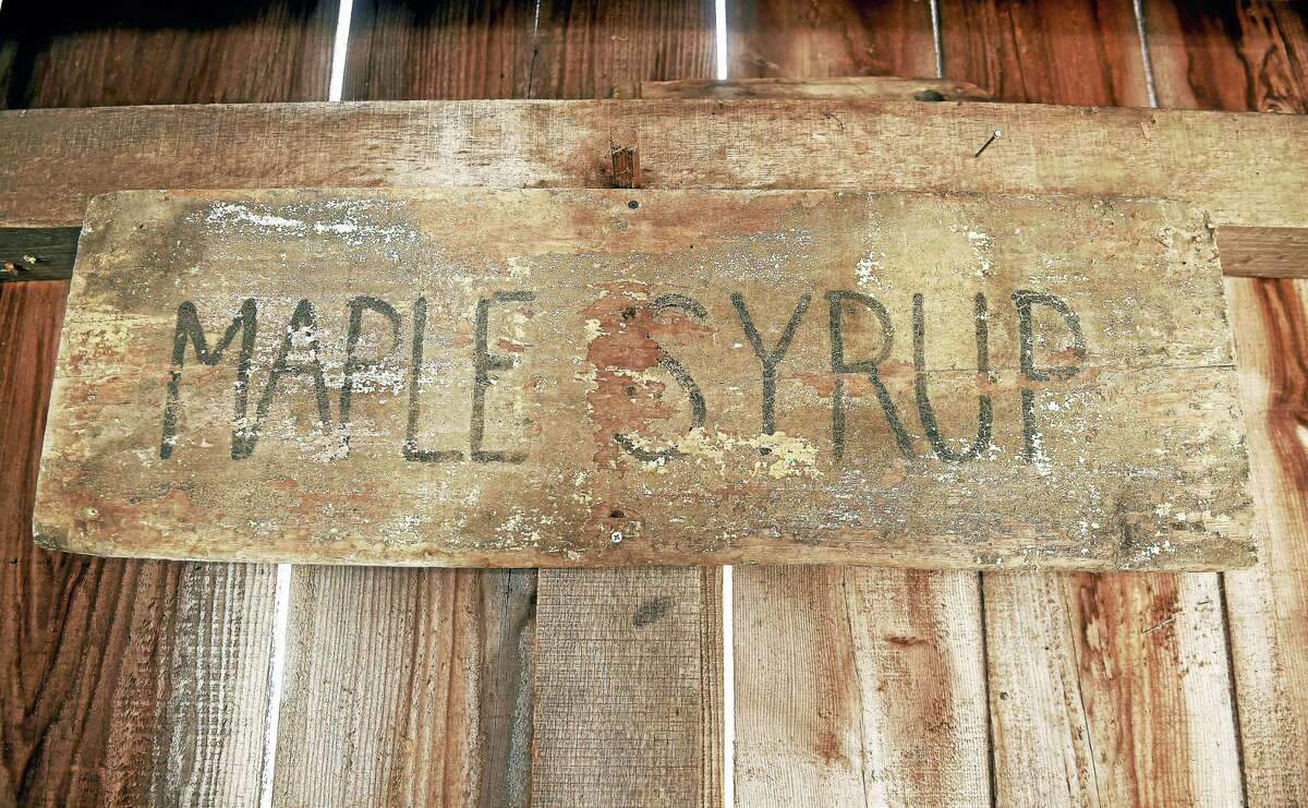 A maple syrup sign hangs in the Sugar Cabin at the Dudley Farm Museum in Guilford on Feb. 4, 2017.