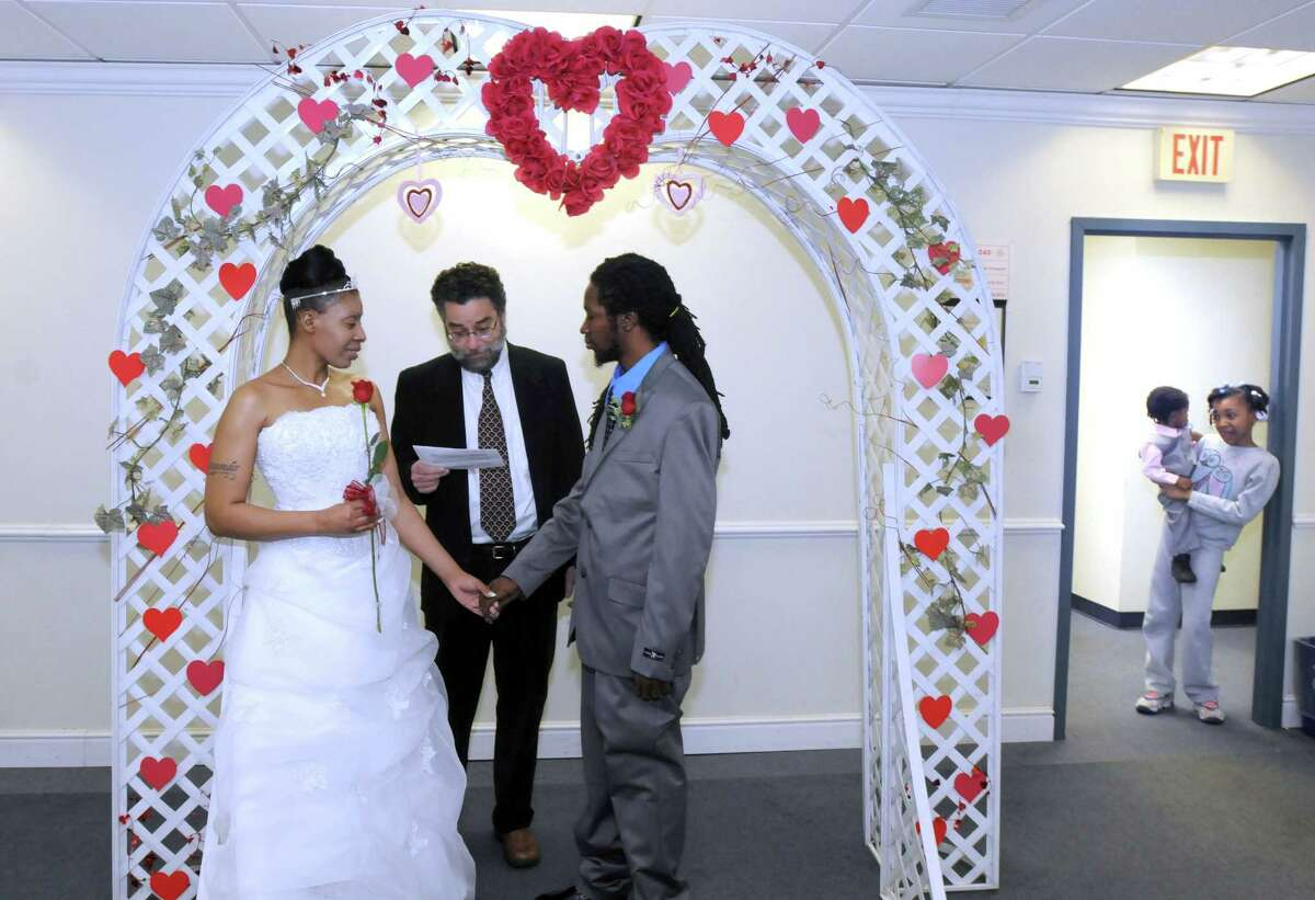 The Hamden Government Center was the location for free Valentine's Day weddings Feb. 14, 2014. Lyrania Durham and Javan Daniels of Hamden tied the knot with Justice of the Peace Michael Ross. Lyriana's daughter Nay'ana Durham, age 8, holds brother Javon Daniels, age 1.