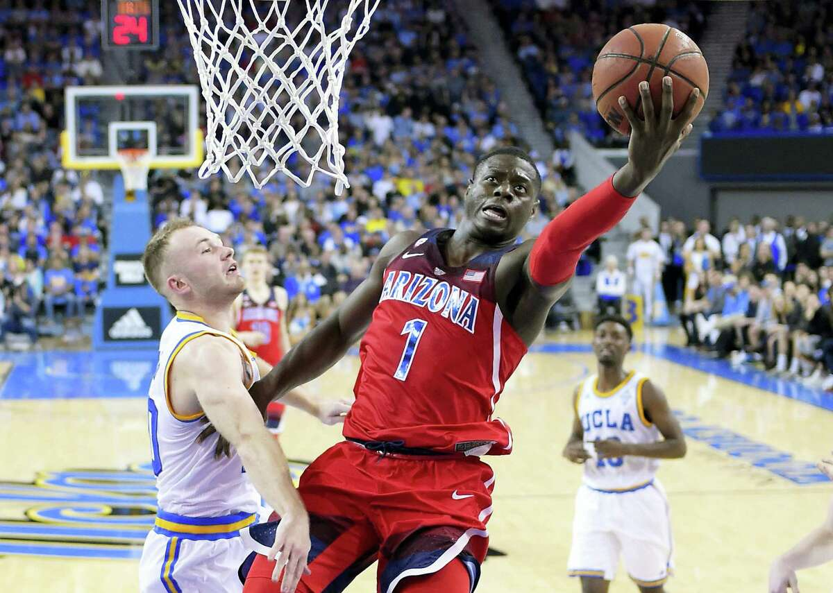 Arizona guard Rawle Alkins, right, shoots as UCLA guard Bryce Alford defends during their game on Saturday.