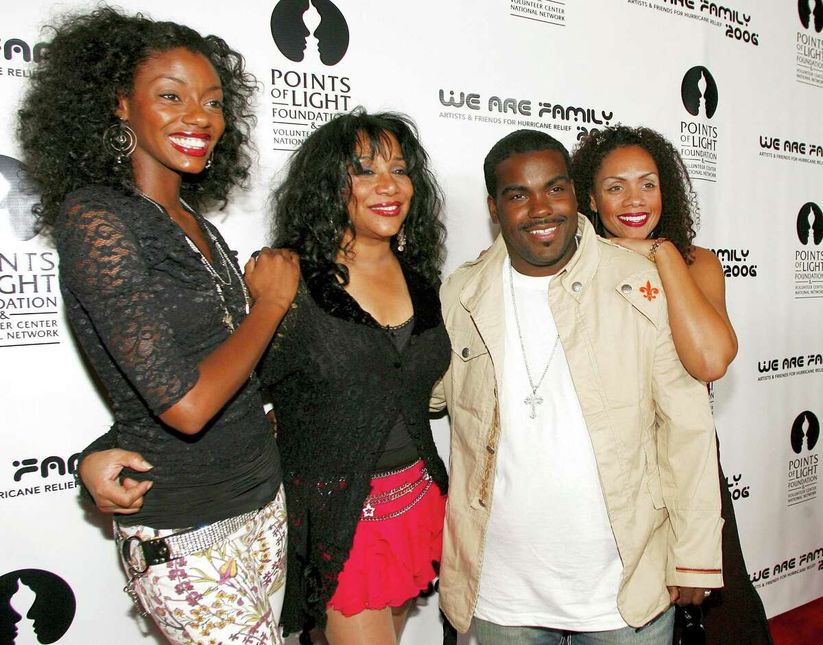 """This Aug. 14, 2006 photo shows Joni Sledge, one of the original members of """"Sister Sledge,"""" second from left, posing with Rodney Jerkins, second from right, her niece Camille Sledge, left, and her cousin Amber Sledge at the """"We Are Family 2006 — All-Star Katrina Benefit CD and Documentary DVD Launch"""" in Century City, Calif. Sledge, who with her sisters recorded the defining dance anthem """"We Are Family,"""" has died, the band's representative says. She was 60."""