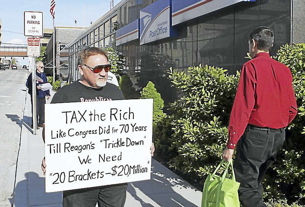 In this April 17, 2012, photo, James Hodgkinson of Belleville protests outside of the United States Post Office in Downtown Belleville, Ill. A government official says the suspect in the Virginia shooting that injured Rep. Steve Scalise and several others has been identified Hodgkinson.