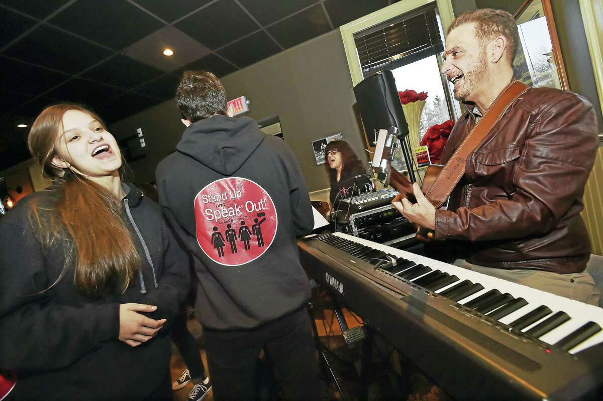 "Madison resident Riki Klaskin, 16, who plays the role of Rea in Stand Up and Speak Out, sings ""Her Song"" with Nick Fradiani, Sr. with members of the cast during the Pledge to Stop Bullying fundraiserat Brother Mike's Restaurant and Bar at 56 Academy Road in Madison. Klaskin said, ""I'm the lead bully, unfortunately."" (Catherine Avalone/New Haven Register)"