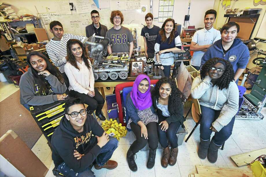 Members of the Hill Regional Career High School robotics team, the Elm City Robo Squad following their championship win at FIRST STEAMWORKS, the FIRST Robotics Competition at a district event at Hartford Public High School April 2. Front row, from left, Akram Ahmed, Shamla Fazl, Poorna Balakumar and Seynabou Ndiaye. Back row, from left, Sumaiya Nizam, Manik Soomra, Moxa Patel,  David Thomas, Josh Shampnois, Joe Ostuno, Selma Abouneameh, Shiv Patel, Rich Tran. Photo: Catherine Avalone — New Haven Register   / Catherine Avalone/New Haven Register