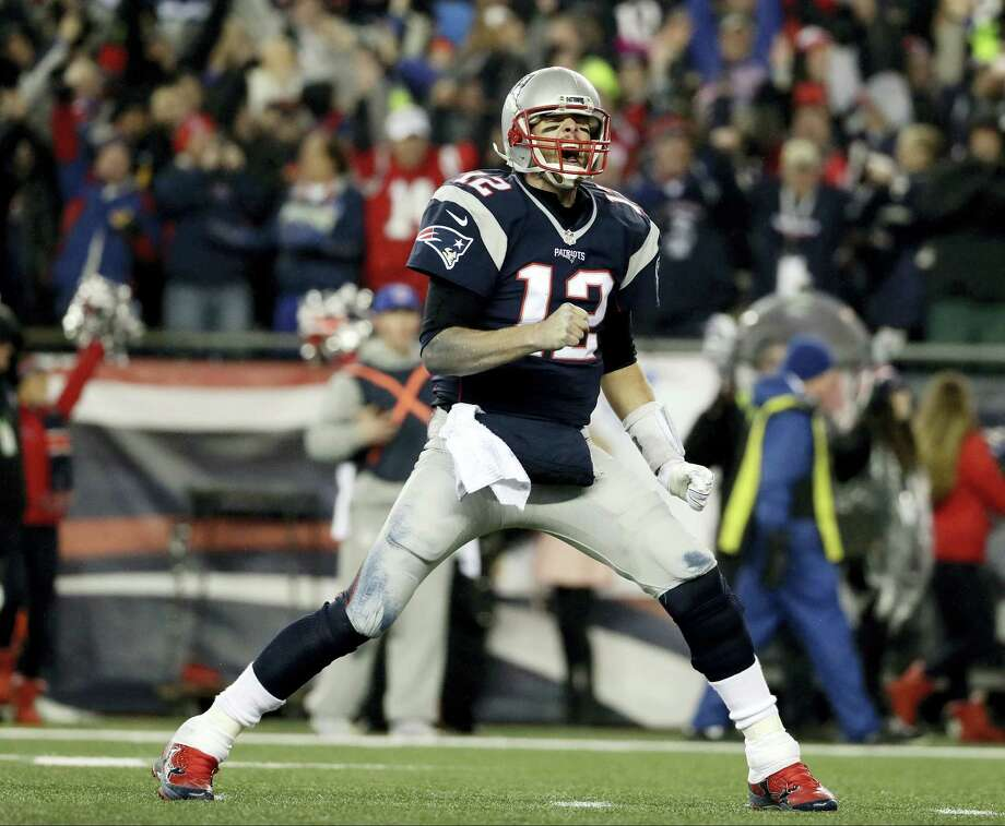 Patriots quarterback Tom Brady reacts after throwing a touchdown pass in the second half Sunday. Photo: Matt Slocum — The Associated Press   / Copyright 2017 The Associated Press. All rights reserved.