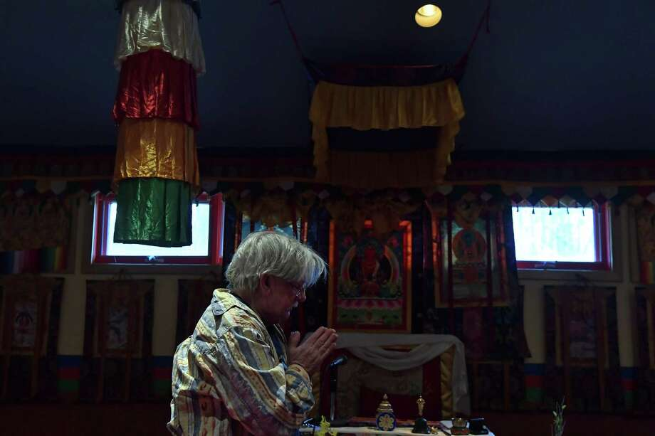 """David Weiss, who is interested in Buddhism, seeks peace and calmness at the Tibetan Meditation Center in Frederick, Md. A favorite mantra is """"Pull a weed, plant a flower."""" Photo: Washington Post Photo/Katherine Frey   / The Washington Post"""