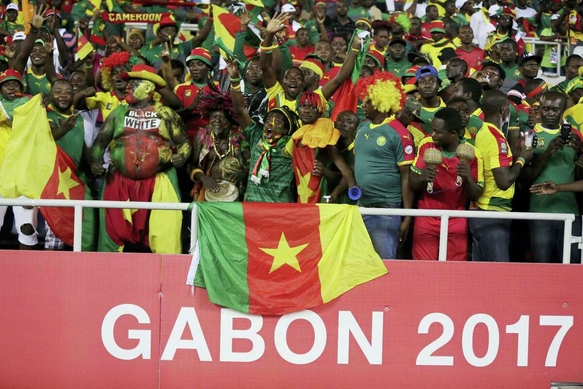 Cameroon's supporter chant ahead of the African Cup of Nations Group A soccer match between Cameroon and Gabon at the Stade de l'Amitie, in Libreville, Gabon on Jan. 22, 2017.