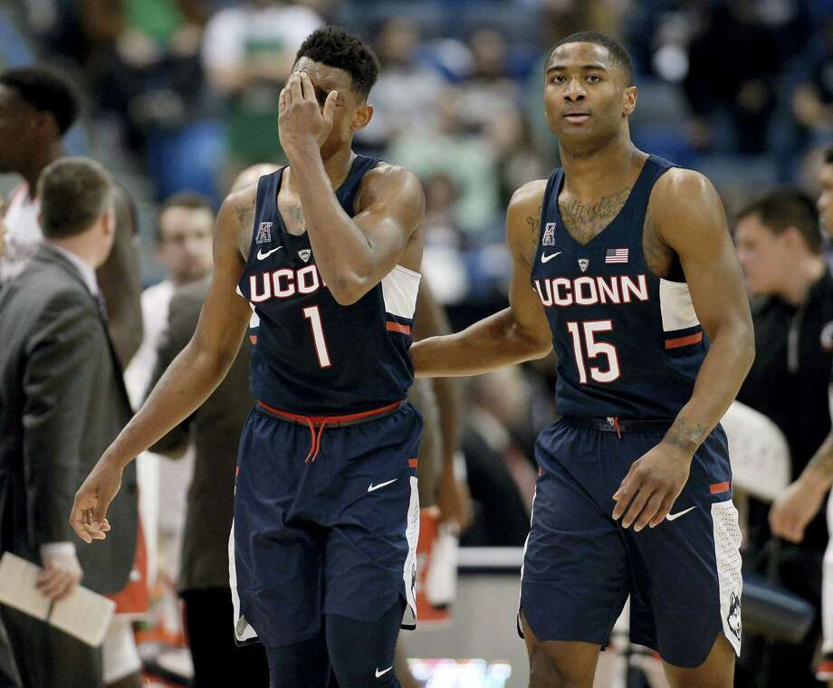 UConn's Christian Vital, left, and Rodney Purvis react during the second half of Saturday's loss to Cincinnati. Photo: Jessica Hill — The Associated Press   / AP2017