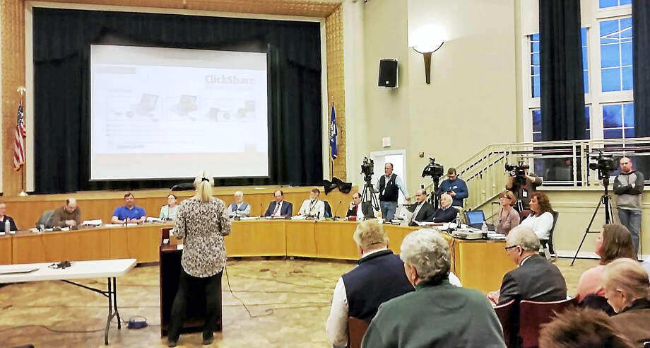 The Hamden Inland Wetlands Commission listens to resident Roberta Mack testify against Mountain View LLC's application to build 288 apartments on Rocky Top Road. Photo: KATE RAMUNNI — NEW HAVEN REGISTER