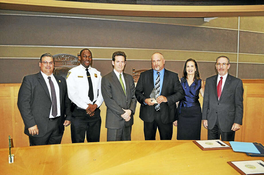 From left, New Haven Police Lt. Herbert Johnson, New Haven Police Chief Anthony Campbell, Assistant U.S. Attorney Mike Gustafston, New Haven police Sgt. Karl Jacobson, U.S. Attorney Deirdre Daly and Assistant U.S. Attorney Peter Markle Photo: CONTRIBUTED Photo/Tom Carson