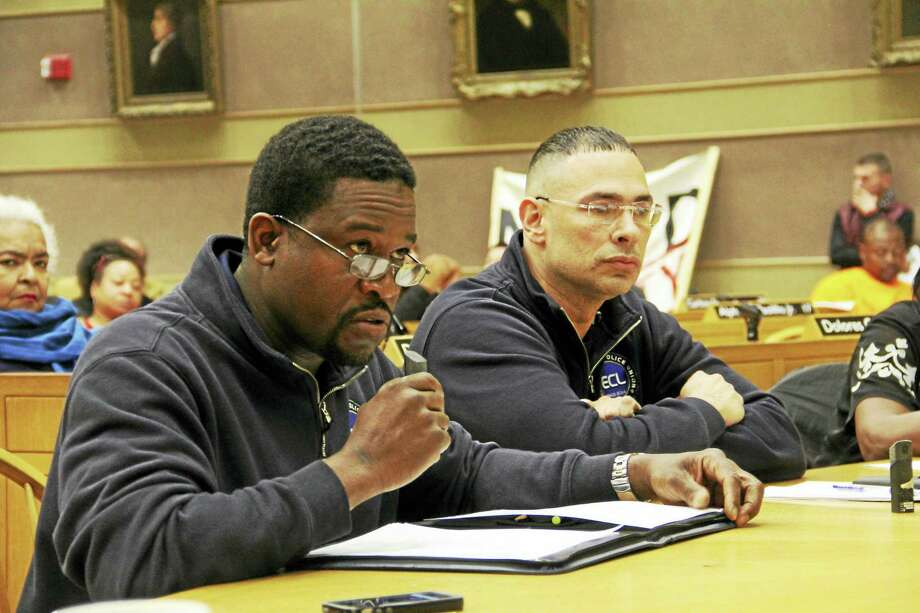From left: New Haven police union Treasurer Sgt. Shafiq Abdussabur and union President Officer Craig Miller during Wednesday's Joint Public Safety and Legislation Committee public hearing at City Hall in New Haven. Photo: Esteban L. Hernandez — New Haven Register