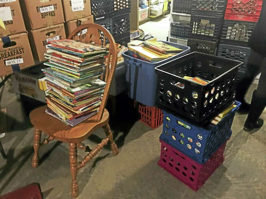 Stacks of books inside the basement of the New Haven Reads' book bank at 45 Bristol St. Thursday in New Haven. Photo: Esteban L. Hernandez — New Haven Register