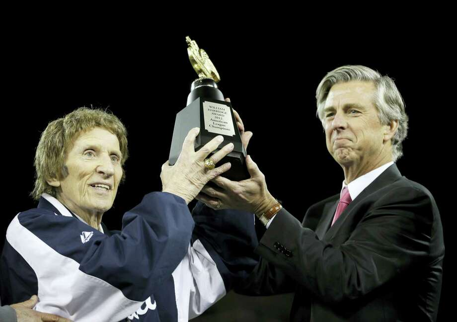 Tigers owner Mike Ilitch, left, and then general manager Dave Dombrowski, lift the William Harridge Trophy after their team won the ALCS in 2012. Photo: The Associated Press File Photo   / Copyright 2017 The Associated Press. All rights reserved.