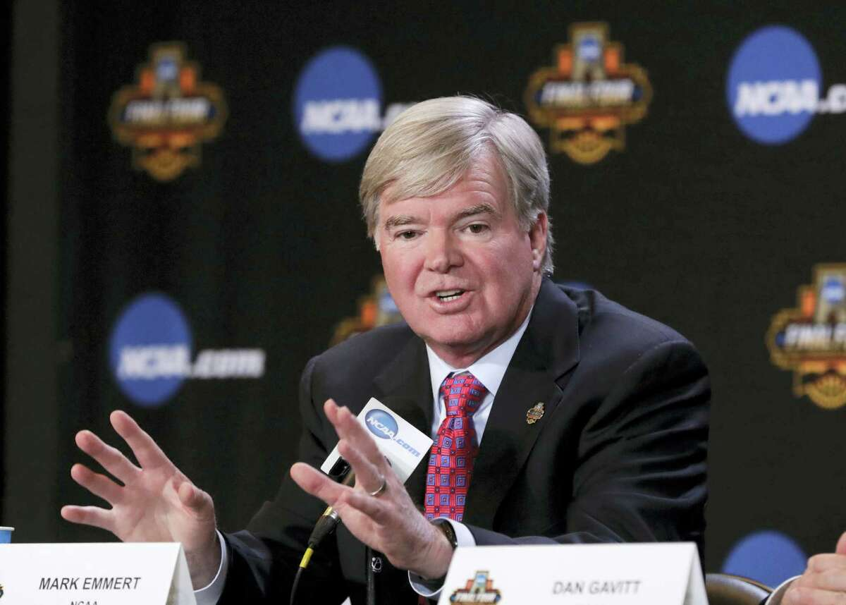 """In this March 30, 2017 photo, NCAA President Mark Emmert answers a question at a news conference in Glendale, Ariz. The NCAA says it will consider North Carolina as a host for championship events again after the state rolled back a law that limited protections for LGBT people. In a statement on April 4, 2017, the governing body said its Board of Governors had reviewed moves to repeal repealed the so-called """"bathroom bill"""" and replace it with a compromise law."""