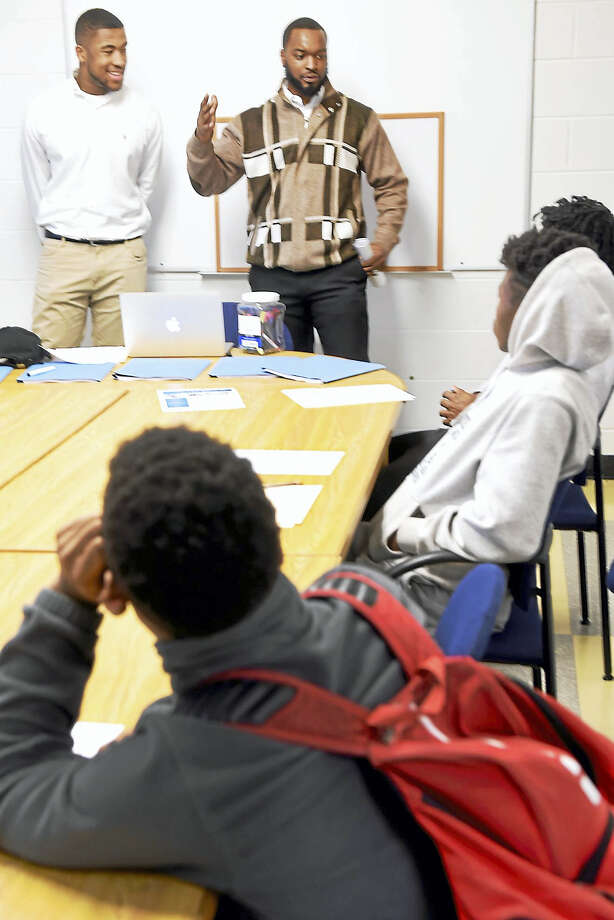 Keerome Lawrence of New Haven, right, a football player and 2011 graduate of Georgetown University who graduated from Hillhouse High School in 2007, initiates the Extra Yard College Prep Program that provides a structured learning environment with student athletes, helping them prepare for  the academic rigors of being a student-athlete in college. At left is Gateway Community College sophomore  Elijah Hampton, 19, of New Haven who was asked by Lawrence to  share to the Hillhouse H.S. student-athletes his experiences of the realities of college and the need to be disciplined and organized while in college. Photo: Peter Hvizdak - New Haven Register   / ©2017 Peter Hvizdak