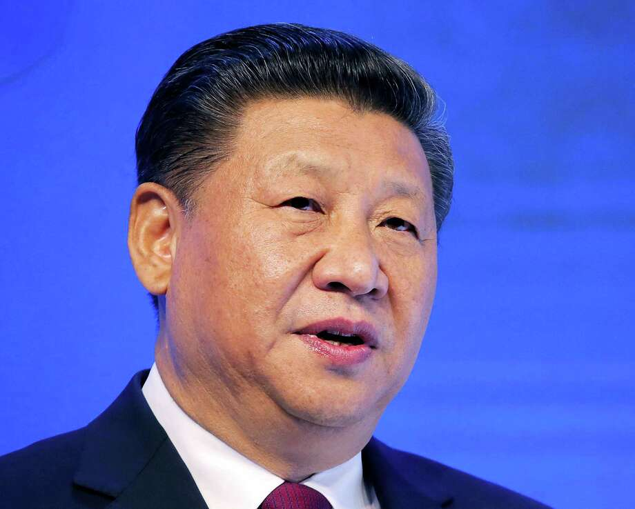 """In this  Jan. 17, 2017, file photo, Chinese President Xi Jinping speaks at the World Economic Forum in Davos, Switzerland. U.S. President Donald Trump has reaffirmed America's long-standing """"one China"""" policy in a telephone conversation with Xi that could alleviate concerns about a major shift in Washington's approach to relations with Beijing. The long-awaited call came Thursday, Feb. 9, 2017, Washington time, the White House and China's state broadcaster CCTV said. Photo: AP Photo/Michel Euler, File    / Copyright 2017 The Associated Press. All rights reserved."""