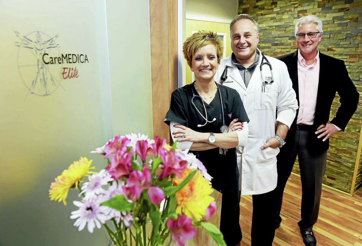 Janine Koukos, CareMEDICA Elite executive clinical coordinator, Dr. Fausto Petruzziello, director of medical services, and George Kulp, director of membership services, left to right, at the CareMEDICA Elite Hamden office. CareMEDICA Elite patients have a dedicated physician who attends to a limited number of patients, so they spend much more face-to-face time with their doctor at each appointment and receive personalized care that is customized to their individual health and wellness goals. Thursday, Feb. 2, 2017