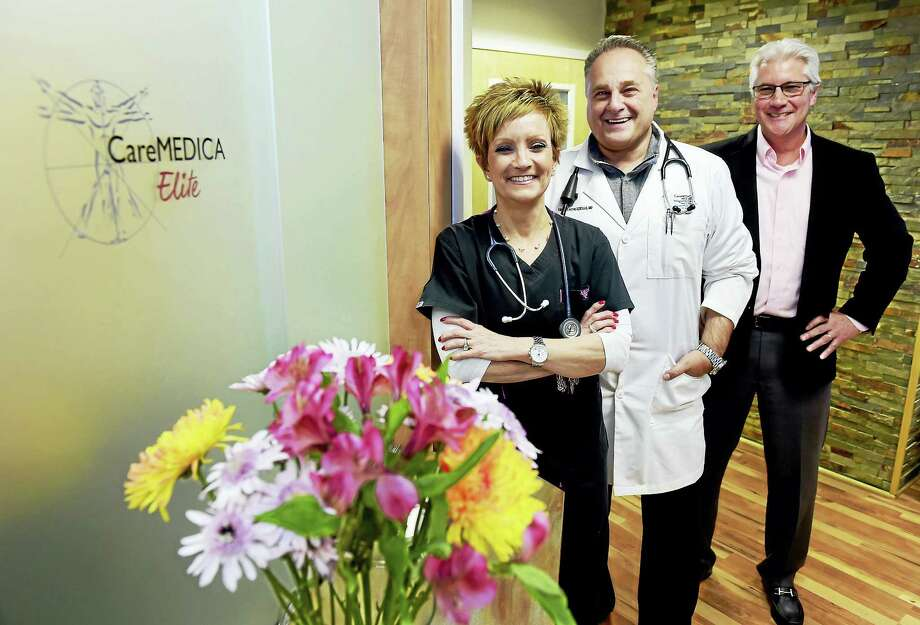 Janine Koukos, CareMEDICA Elite executive clinical coordinator, Dr. Fausto Petruzziello, director of medical services, and George Kulp, director of membership services, left to right, at the CareMEDICA Elite Hamden office. CareMEDICA Elite patients have a dedicated physician who attends  to a limited number of patients, so they spend much more face-to-face time with their doctor at each appointment and receive personalized care that is customized to their individual health and wellness goals. Thursday, Feb. 2, 2017 Photo: Peter Hvizdak - New Haven Register   / ©2017 Peter Hvizdak