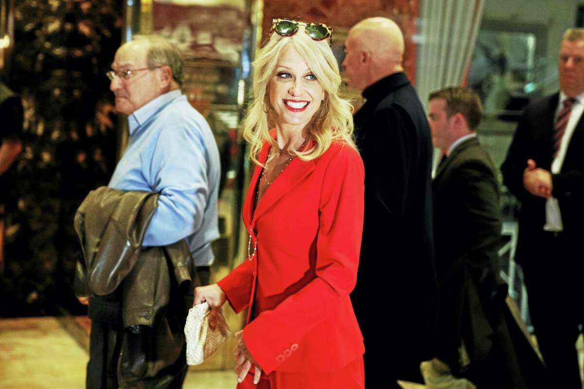 Kellyanne Conway walks past reporters in the lobby of Trump Tower, Monday, Nov. 28, 2016, in New York.