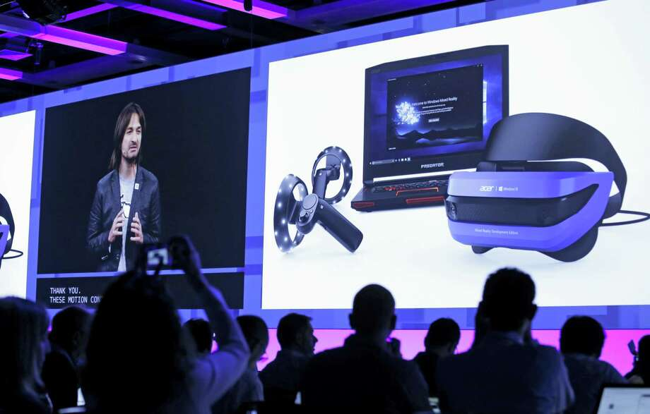 Audience members look on as Alex Kipman, a technical fellow at Microsoft, talks about Windows Mixed Realty at the Microsoft Build 2017 developers conference Thursday, May 11, 2017, in Seattle. Photo: Elaine Thompson — AP Photo   / AP