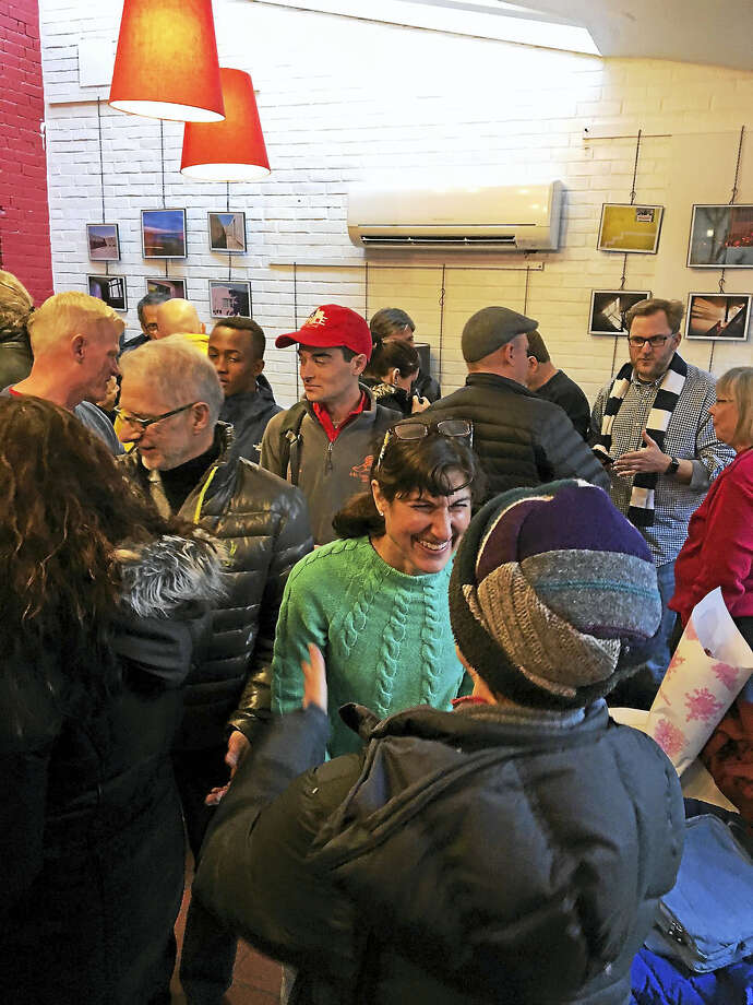 A large crowd greets Abbe Roth Saturday who is running for Ward 7. Photo: Mary O'leary - New Haven Register