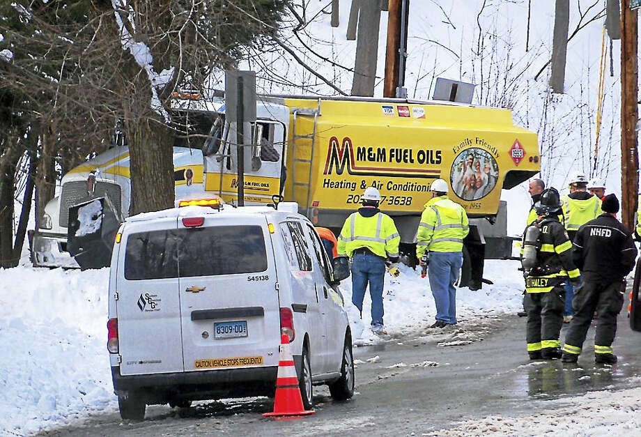 Parts of Forest Road and Chapel Street were shut down in Westville for about two hours Friday after an oil truck crashed into a utility box, resulting in a gas leak. No one was hurt in the accident. Photo: (Wes Duplantier -- The New Haven Register)
