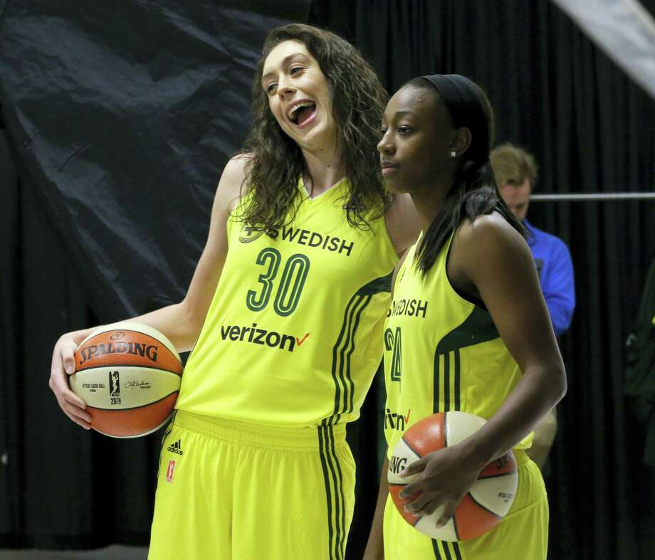 Seattle Storm forward Breanna Stewart, left, and guard Jewell Loyd pose for photos during the Seattle Storm's annual media day last week. After a much needed break, Stewart is ready for her second season with the Seattle Storm. Photo: TED S. WARREN — The Associated Press   / Copyright 2017 The Associated Press. All rights reserved.